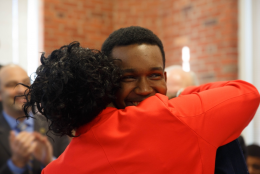 Adonte Yearwood gets a hug from his mother, Dorene Browne-Louis.png